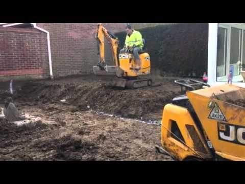 Video D.M.S Micro Digger Hire. Micro digger manoeuvring from one level to another download in MP3, 3GP, MP4, WEBM, AVI, FLV January 2017