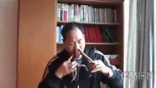 Chinese Man Pushing Snake In His Nose - WTF