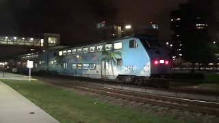 Southbound Tri-Rail Passenger Train with Loco #812 [GP49PH-3] is pulling two passenger cars.