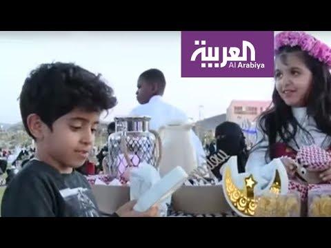 العرب اليوم - شاهد:التاجر الصغير يبدع في مهرجان الورد الطائفي