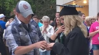 Aaron Barbarick surprised his girlfriend Maddison Figg at her nursing school graduation with a car and an engagement ring. Barbarick bought Figg a brand new 2017 Dodge Durango GT. After Figg saw her new car she noticed her Barbarick and his son down on one knee, engagement ring in hand, asking for her hand in marriage.Watch the original video here:  https://www.youtube.com/watch?v=q0hiaUeMDT4#graduation #dating #love #romance #proposal #engagement #ring #carConnect with the RightThisMinute hosts!Charity Bailey: http://twitter.com/baileysblastGayle Bass: http://twitter.com/gaylebassNick Calderone: http://twitter.com/nscalderoneOli Pettigrew: http://twitter.com/oli_pettigrew—————RightThisMinute is THE viral videos show – now seen in over 90% of the U.S. on America's best TV stations. We have the stories behind the best web videos with interviews and information you won't find anywhere else. Every day, our team of e-journalists scour the internet to find you the videos everyone will be talking about. Our hosts then share the best of these on TV, online, and on mobile. If it's funny, outrageous, informative or entertaining, you'll see on #RightThisMinute here first.RightThisMinute.com is the companion site for the TV show. Updated daily, you'll find show clips and other great videos you may not see on TV. Bookmark www.RightThisMinute.com and do come back often to find out what's trending every day.Get RTM on your mobile device by downloading the RTM Videos app at http://www.rightthisminute.com/apps — available for IOS, Android and Windows — or watch us on Apple TV.