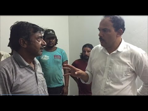 A sailor talking to the Indian Consular agent in Jalan Bani Bu Ali after being rescued by the Royal Oman Police and Omani fishermen