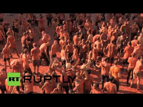 sanctions - Dozens wearing goggles and shower caps took to the streets of Dam square in central Amsterdam to take part in a massive tomato fight in protest of Russian sanctions, Sunday. The tomato fight...