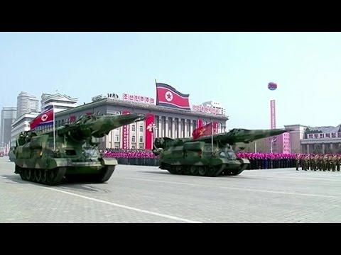 North Korea parades new missiles