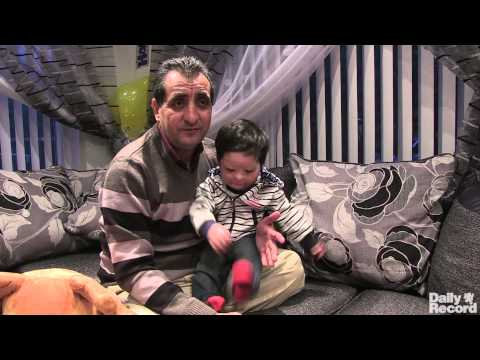 celebrates - Burns victim Mohammad Sudais celebrates his first birthday with his uncle Mohammad Asif at home in Glasgow. The young boy suffered 80 per cent burns to his face after being caught in an explosion...