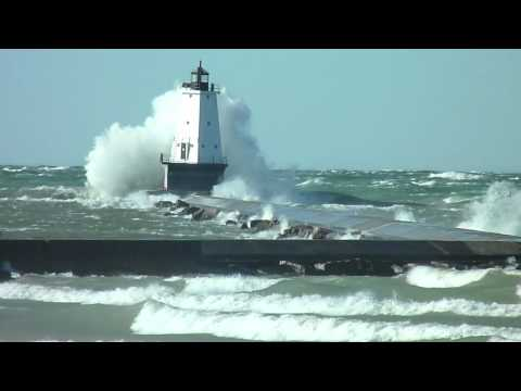 Lighthouse engulfed by huge wave