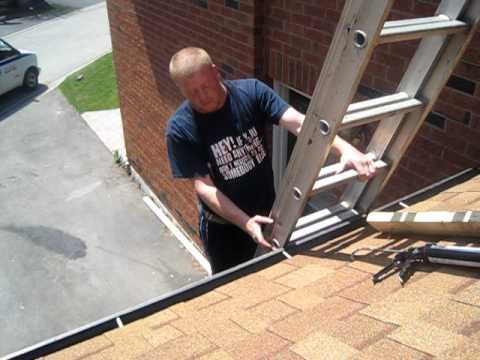 ladder - Elvis Benoit from rooftuneup.ca showing how to safely use a ladder to go on your roof.