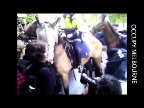 Occupy Melbourne – violent cop hits peaceful protester in the face