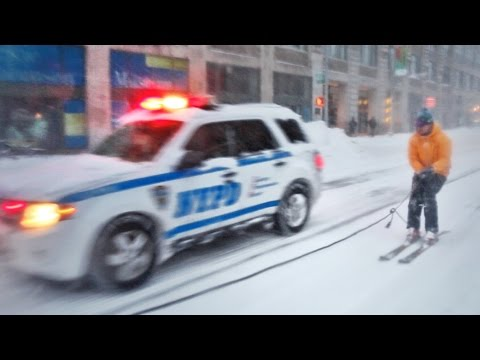 A daredevil goes snowboarding on the streets of NY