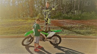 4. 10 year old kid rides the kx 450f. That thing has some power!!