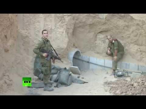 Footage - The IDF released video that shows Israeli soldiers discovering a hidden Hamas tunnel. The entrance to the tunnel was concealed inside a tin shack. Robots mounted with cameras were sent down...