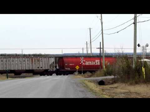 8903 - It's a cold, windy day out in Central Ontario. CP 114 is in a rush. Like an angry moose coming out of the forest, the train is climbing away from the Lake On...