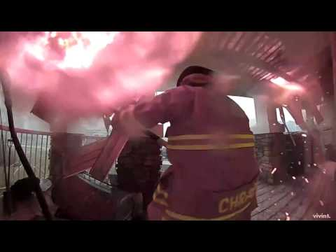 Firefighters battle to save house