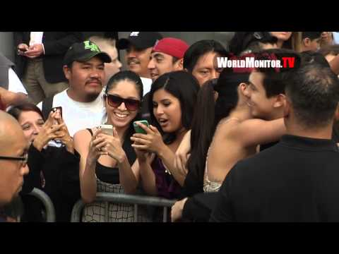 Shows - http://worldmonitor.tv Please click on the link above to visit our website and remember to subscribe to this channel! Selena Gomez shows mad love for the fans arriving at 'Behaving Badly' Los...