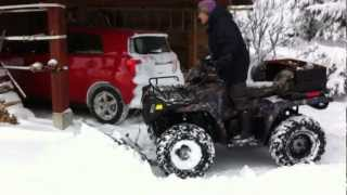 10. Polaris Sportsman 500 EFI Glacier Snow Plow