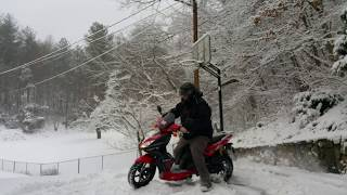 8. 2010 Kymco Super 8 in the Snow