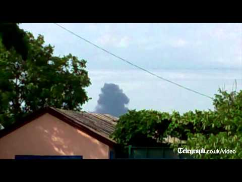 Footage - More footage has surfaced on social media showing smoke billowing upwards following reports a Malaysian Airlines flight has been shot down over the Ukraine-R...