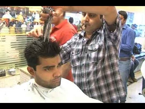 Using - Hairdresser grooms Umar Akmal using 14 scissors for Henna Ceremony https://www.youtube.com/dunyanews1 Don't forget to