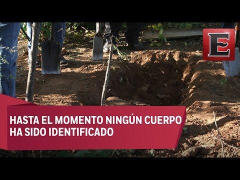 Recuperan 32 cuerpos y nueve cabezas en fosas clandestinas de Zitlala