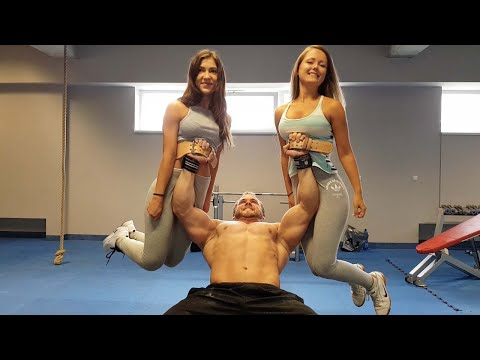 Man Bench Presses Two Girls