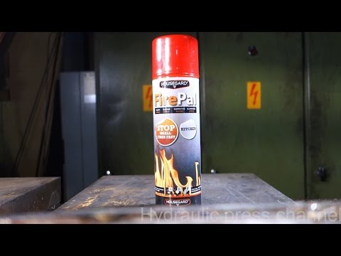 Crushing small fire extinguisher with hydraulic press