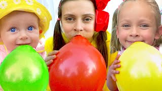 Maya and Mary plays with balloons for kids