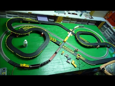 HO SLOT CARS vs FREIGHT TRAIN HO Scale Layout - Crashes at Road & Rail crossing