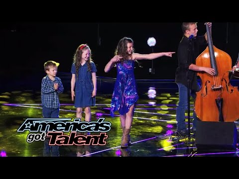 family - The good-looking musical family plays music, performs an Irish dance, and sings a folksy rendition of