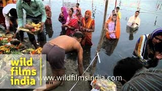 image of Women offer pray to Sun God during Chhath puja