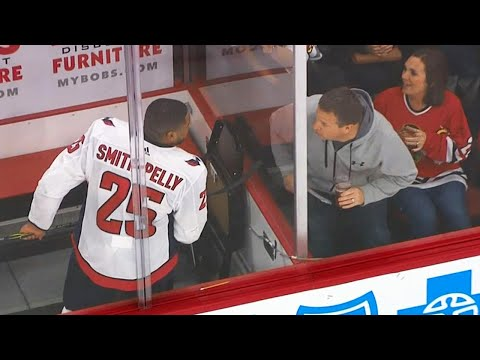 Video: Fans get the boot after harassing Smith-Pelly in penalty box
