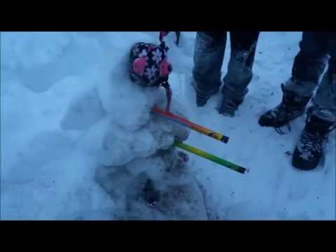 Two Snowmen Doing Battle With Fireworks