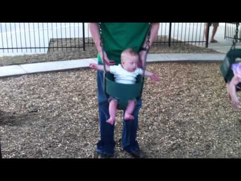 Watch video Down Syndrome kid playing on a swing set
