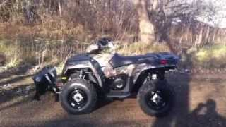 4. 2013 Polaris Sportsman 500 with 52