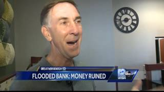 The floodwater reached nearly two-feet deep inside Burlington's Fox River State Bank.   The bank's president and CEO, Keith Pollek, said bank vaults are built to be water resistent, but they aren't guaranteed to be water proof.Subscribe to WISN on YouTube for more: http://bit.ly/1emE5YXGet more Milwaukee news: http://www.wisn.com/Like us: http://www.facebook.com/wisn12Follow us: http://twitter.com/WISN12News