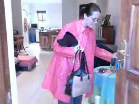 Rainweargirl - A short phonecam clip of Rainweargirl leaving home. As always dressed in rainwear even though there was no sight of rain. This time round it is a red PVC rai...