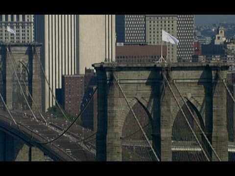 white - New York police are investigating after two American flags disappeared from the top of the Brooklyn Bridge on Monday night, and were replaced by white banners Get the latest headlines http://www....