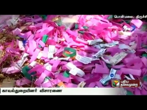 Evidence-of-currencies-been-dismantled-from-bundles-in-Trichy-near-Ponmalai