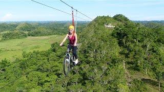 Download Lagu Tourists Ride Bicycle Over Zipline Mp3