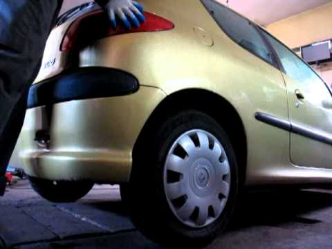 tylna belka Peugeot 206 skrzypi
