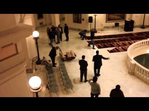 CAIR lays out prayer rugs while American patriots observe from the rotunda