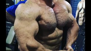 Iraqi bodybuilding champion Ali Hani showing his massive muscles