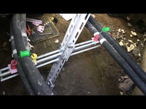 Обустройство типового колодца МРСК кабельными системами Русэнерго в Украине