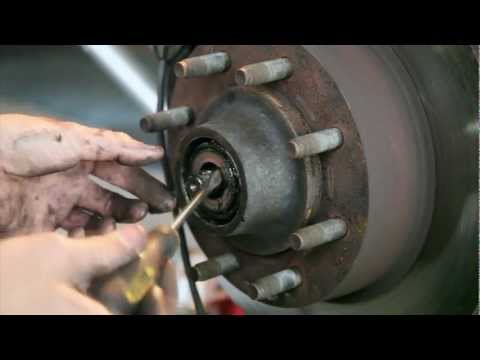 How to change the front brake pads and wheel bearings on a 2008 Ford E150
