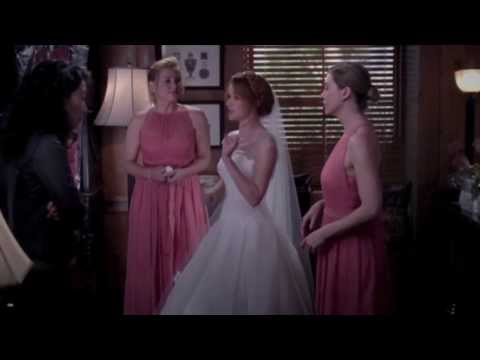 Bridesmaids helping the bride with the dress