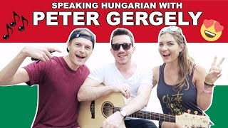 ► SUBSCRIBE TO PETER: https://www.youtube.com/user/GPeti2► INSTAGRAM: http://instagram.com/petergergelymusic---- ↓↓↓ Click 'SHOW MORE' below to see more information ↓↓↓► Feliratkozás: http://bit.ly/TravellingWeasels► Subscribe: http://bit.ly/TravellingWeasels► Meet-Up Information: http://bit.ly/MagyarMeetUp► Facebook Group: http://bit.ly/MagyarWeaselsWe have arrived in Hungary! Not only that, but we had the BEST arrival we have ever had! If you haven't seen it yet, watch Vlog number one here: http://bit.ly/HungaryVlogs2017 Today we spoke some Hungarian with Hungarian solo acoustic guitarist Peter Gergely! Join our Facebook Group for more information on upcoming meet-ups: http://bit.ly/MagyarWeasels Also, read the blog post for all our meet-up dates: http://bit.ly/MagyarMeetUpHave you seen all the 'Speaking Hungarian' videos? Watch them now:PART 1 https://youtu.be/FsKQEPJXKJMPART 2 Megszentségteleníthetetlenségeskedéseitekért: https://youtu.be/-IXg4NR9zaUPART 3 Hungarian Tongue Twisters: https://youtu.be/VXS0RLTm8_gPART 4 A Magyar ÁBÉCÉ: https://youtu.be/MnU7jC7QJAMPART 5 ANGOLOK MAGYARUL: https://youtu.be/RgI88oSpYlIPART 6 NEMZETI ÜNNEP: https://youtu.be/_hspDZgFcOUPART 7 SZÁMOK: https://youtu.be/QeXL5r6AcFUPART 8 KASSZÁS ERZSI: https://youtu.be/4l_iKWieOd0PART 9 ÁLLATOK: https://youtu.be/ds-Q7uPlFnUPART 10 MAGYAR YOUTUBERS: https://youtu.be/0KwPpTBh4pIPART 11 MAGYAR MUSIC: https://youtu.be/WTLwXYxecdkPART 12 ÉTEL: https://youtu.be/H6TVecbZTggPART 13 JOCI PÁPAI: https://youtu.be/DxMrycK-aVIPART 14 MAGYAR APP: https://youtu.be/YQeYLQ0h7JMPART 15 MAGYAR ROCK: https://youtu.be/fxVcwjJxASM PART 16 TMI TAG: https://youtu.be/uqiBJ0eu9OsPART 17 YOUTUBERS: https://youtu.be/SE4t8Y3-82kPART 18 TALÁMÁNYOK: https://youtu.be/alTZQydU__MPART 19 PALVIN BARBARA: https://youtu.be/aabjW0tDi10► Watch our Hungary Playlist here (WE VISITED HUNGARY!): http://bit.ly/HungaryPlaylist 🇭🇺► All Speaking Hungarian Videos: https://youtu.be/FsKQEPJXKJM?list=PLd5RMUGwfy3ss-4hQ6sHOxGLMPOTtu_89► Bin