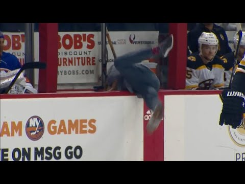 Video: Islanders' cameraman pulls a Donaldson, dives into bench