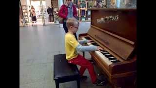 8 year old boy playing Chopin's Fantasie Impromptu at St Pancras Station, London. Self taught from watching YouTube tutorials, after starting to learn piano just ...