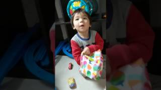 He already knows his cars are in the bag, but he practices his surprised reaction!