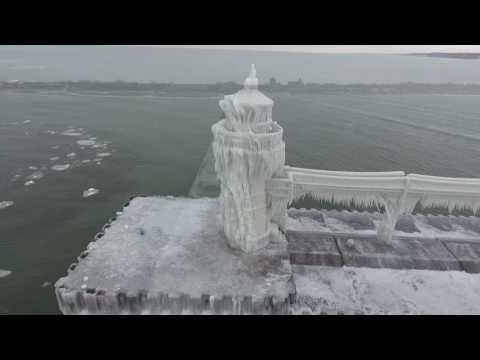 Unbelievable Frozen Lighthouse is One Giant Ice Cube