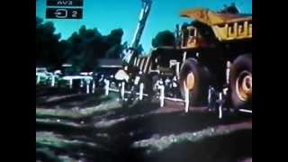 """The annual Mt Nameless festival from about 1980 in Hamersley Irons Tom Price town in WA. A selection of mining equipment was taken from the mine into the towns sports ground for the kids to look at and """"play"""" with, along with other entertainment."""